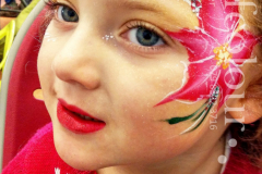 Chrismas-flower-face-painting-side-scaled